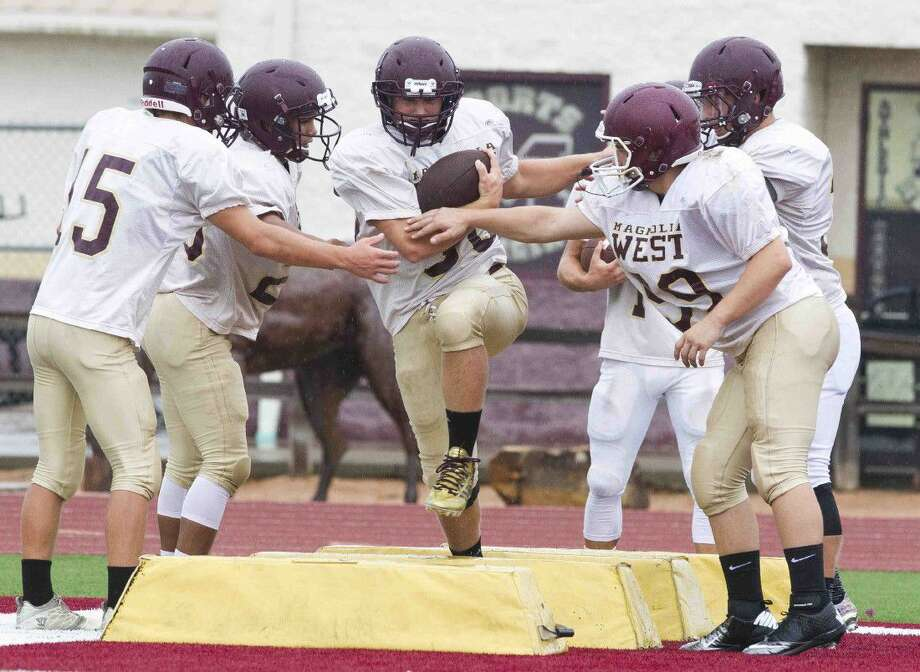 Magnolia West running backs participate in a drill this past Wednesday during practice. Photo: Jason Fochtman