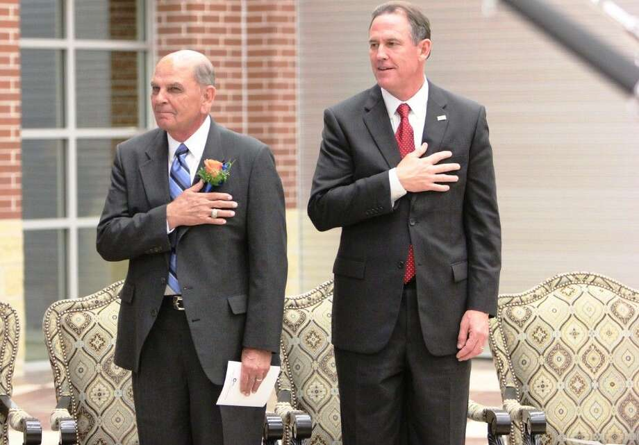 Retired Conroe ISD educator Dr. Charlie Patterson, left, and Conroe ISD Superintendent Dr. Don Stockton say the Pledge of Allegiance during the dedication ceremony of Patterson Elementary last month. The school was named after Patterson after his name was suggested, voted on and approved by the Conroe ISD Board of Trustees in November 2013.