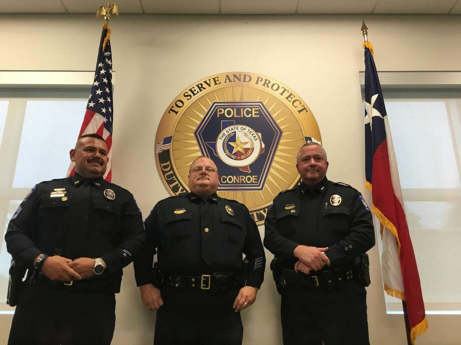 Conroe Police Sgt. Juan Sauceda, Lt. James Kelemen and Deputy Chief Jerry Abbott receive recognition during a promotional ceremony at the Conroe Police Department Thursday.
