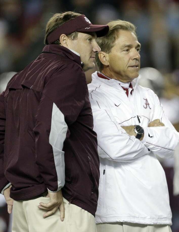 Mississippi State coach Dan Mullen, left, will match wits with Alabama coach Nick Saban today in Tuscaloosa, Ala. Photo: Dave Martin