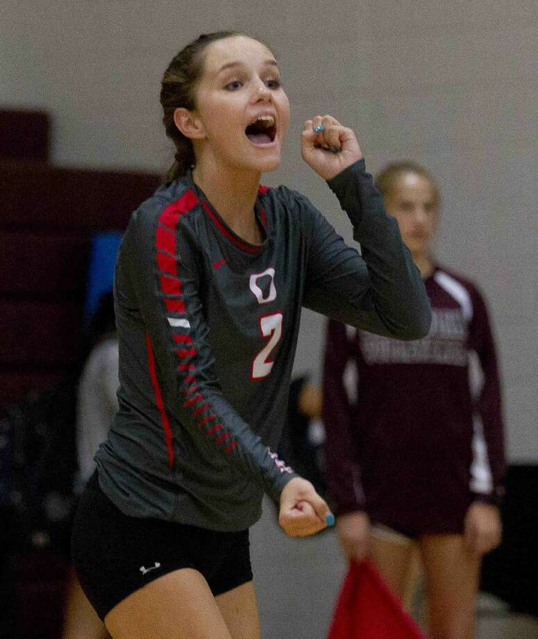 Oak Ridge's Lexi Overman celebrates a point during a pool play match against Willis at the Magnolia Volley-Battle tournament Thursday at Magnolia High School. Go to HCNpics.com to purchase this photo and other like it. Photo: Jason Fochtman