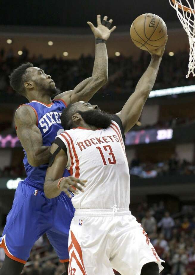 Houston Rockets guard James Harden goes to the basket with Philadelphia 76ers' Tony Wroten at his back in the second half of Friday's game in Houston. Photo: Pat Sullivan