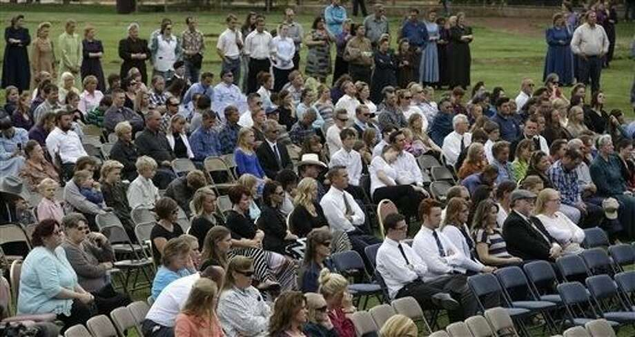 People attend a memorial service in Hildale on Saturday for 12 women and children swept away in a deadly flash flood nearly two weeks earlier on the Utah-Arizona border. One six-year-old boy is still missing. Photo: Rick Bowmer