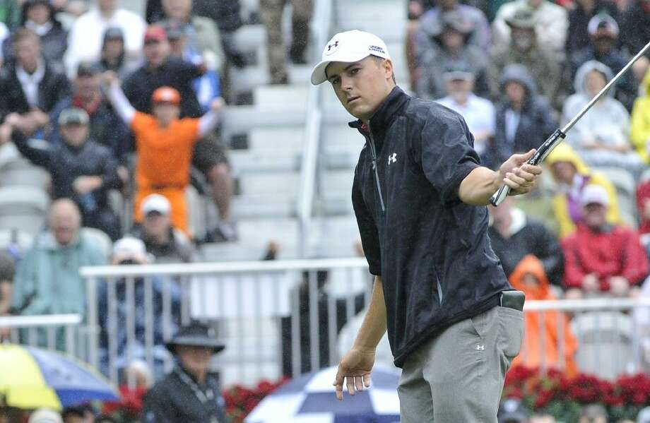 Jordan Spieth watches his birdie putt about to go in on the hole on the 18th green during the third round of the Tour Championship golf tournament at East Lake Golf Club, Saturday in Atlanta. Photo: John Amis