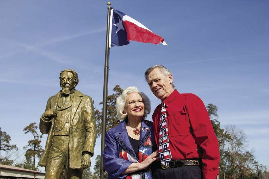 Great-great-great granddaughter of Charles B. Stewart, Pat Spackey and her husband, Ted, stand next to a bronze statue of Stewart during the unveiling of the statue and a 175th birthday of the Lone Star flag celebration at Cedar Brake Park in Montgomery in 2014. Photo: Staff Photo By Ana Ramirez