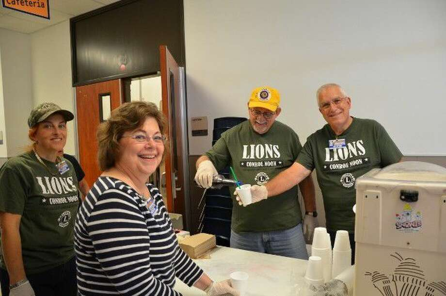 Members of the Conroe Noon Lions Club made sno cones during Field Day activities at the adopted school of Reaves Elementary last Thursday; pictured (left to right) are Donna Trice-Drummond, Phyllis Rainey, Eddie Risha and Ron Carter.