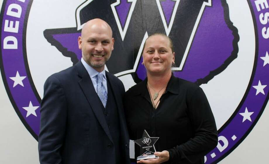 Willis ISD Superintendent Tim Harkrider stands alongside WISD's November MVP and Lynn Lucas Middle School teacher Susan Burge, who was presented with the award during Wednesday's regular school board meeting.