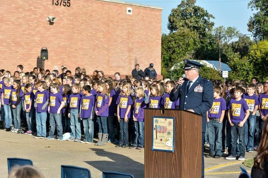 Veteran and Montgomery ISD volunteer Barry Russak speaks in front of Montgomery Middle School on Veterans Day.
