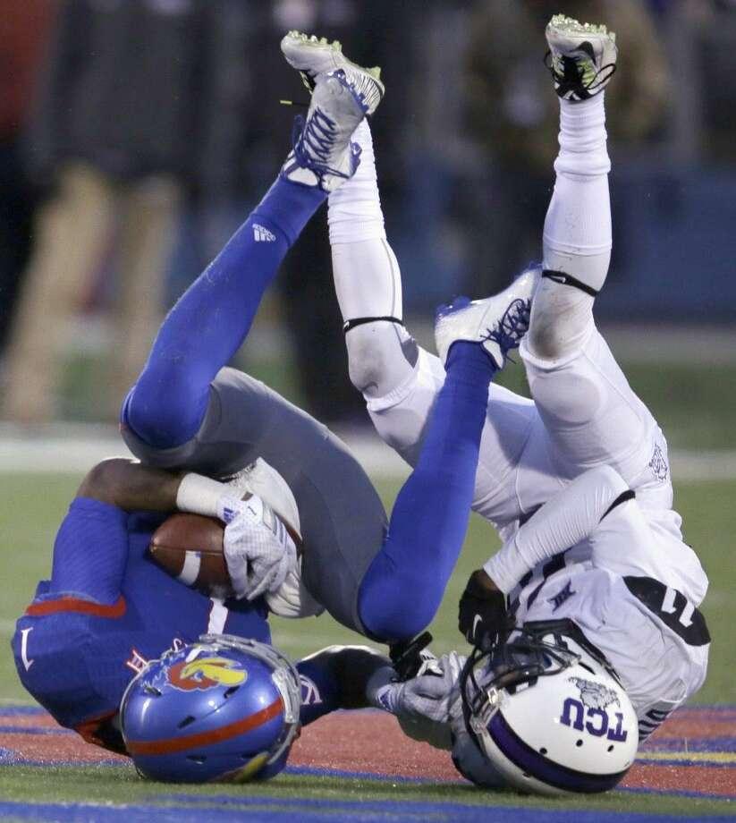TCU cornerback Ranthony Texada tackles Kansas wide receiver Rodriguez Coleman on Saturday in Lawrence, Kansas. Photo: Orlin Wagner