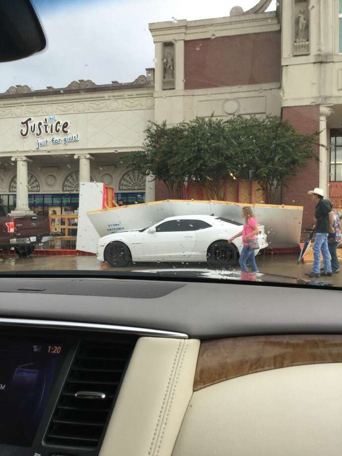 A construction barrier collapsed on two cars driving by stores in the Portofino Shopping Saturday afternoon when a storm with strong winds blew through the area. No injuries were reported.