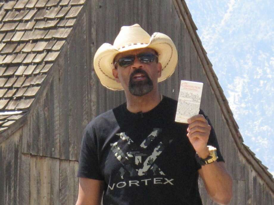 Milwaukee County Sheriff David A. Clarke Jr., who was elected in Wisconsin as a Democrat, holds a pocket-sized copy of the U.S. Constitution on Saturday as he speaks at a Republican rally and barbecue on a northern Nevada ranch south of Carson City, Nev. Photo: Scott Sonner