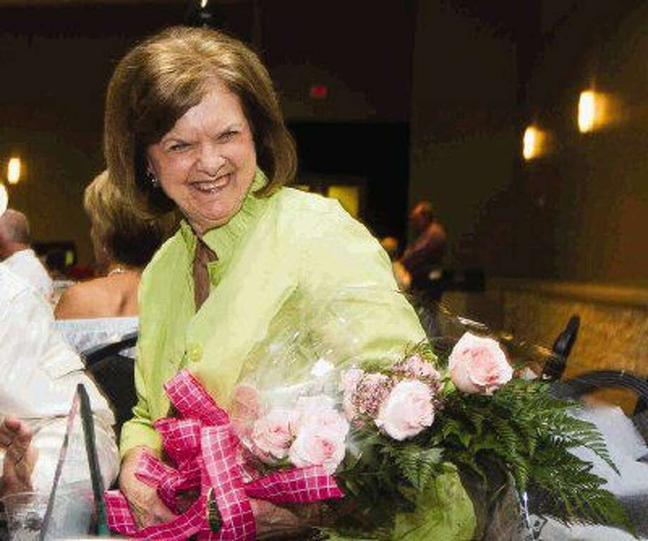 Beth Traylor received the distinguished service award during the annual Montgomery County Fair and Rodeo appreciation dinner Saturday at the Lone Star Convention & Expo Center.
