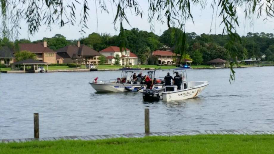 Officials look for the body of a 25-year-old man who drowned in Lake Conroe Saturday after jumping off a pontoon boat.