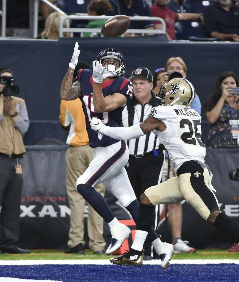 Houston Texans wide receiver Will Fuller (15) catches a 19-yard touchdown pass as New Orleans Saints cornerback P.J. Williams (25) defends in the first half of an NFL preseason football game in Houston, Saturday. Photo: Eric Christian Smith