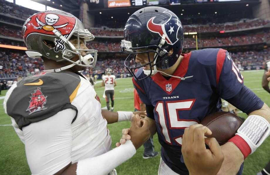 Bucs rookie Jameis Winston, left, congratulates Texans quarterback Ryan Mallett after the Texans' 19-9 victory over Tampa Bay on Sunday. Photo: David J. Phillip