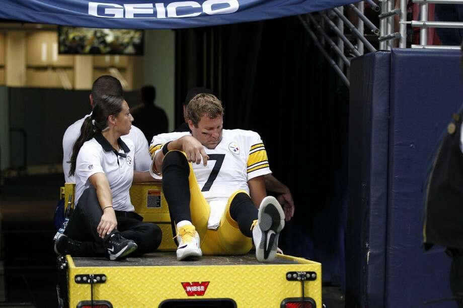 Steelers quarterback Ben Roethlisberger is taken off the field on a cart after being injured against the Rams. Photo: Billy Hurst