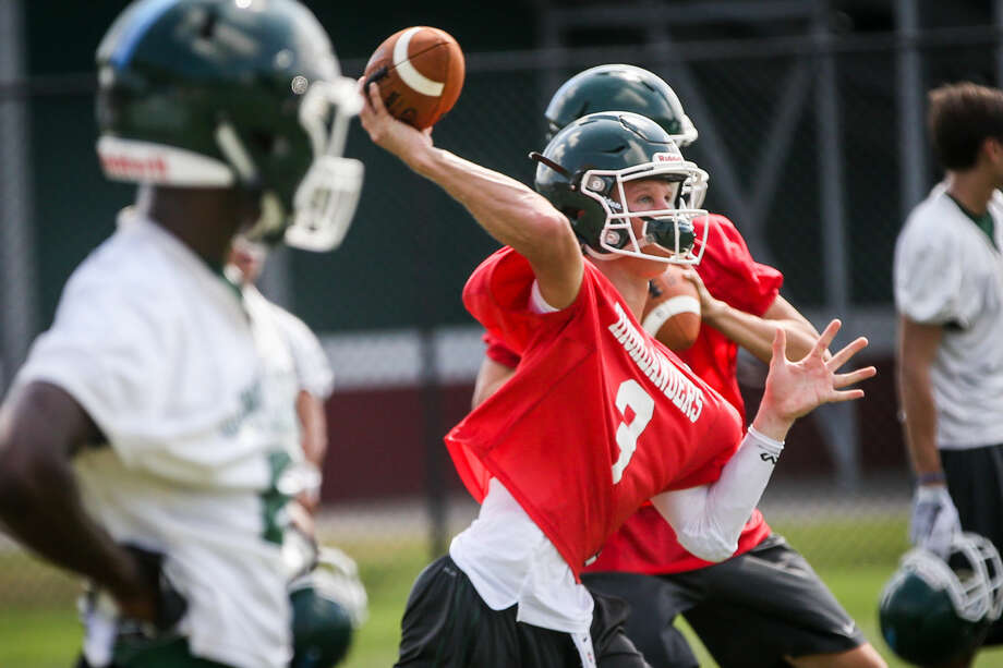 Quarterback Eric Schmid throws a pass during The Woodlands football practice on Monday, Aug. 8, 2016, at The Woodlands High School. Photo: Michael Minasi
