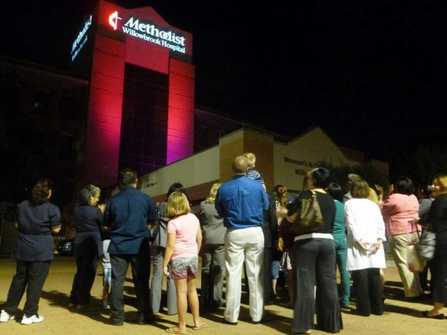 Houston Methodist holds a lighting ceremony in honor of Breast Cancer Awareness Month.