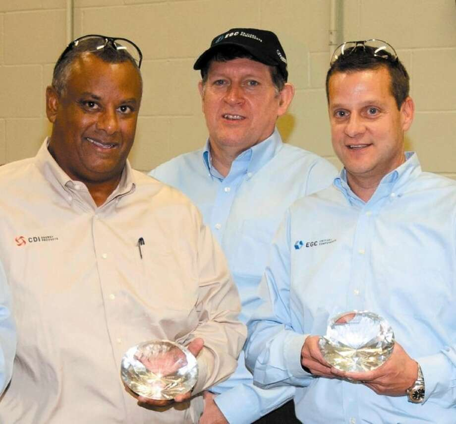 """On behalf of their employees, CDI and EGC general managers accept Fenner's inaugural """"Millionaire's Club"""" Award for safety excellence. (from left) Victor Jackson, general manager CDI, Nicholas Hobson, CEO Fenner PLC and Mike Boylan, general manager EGC."""