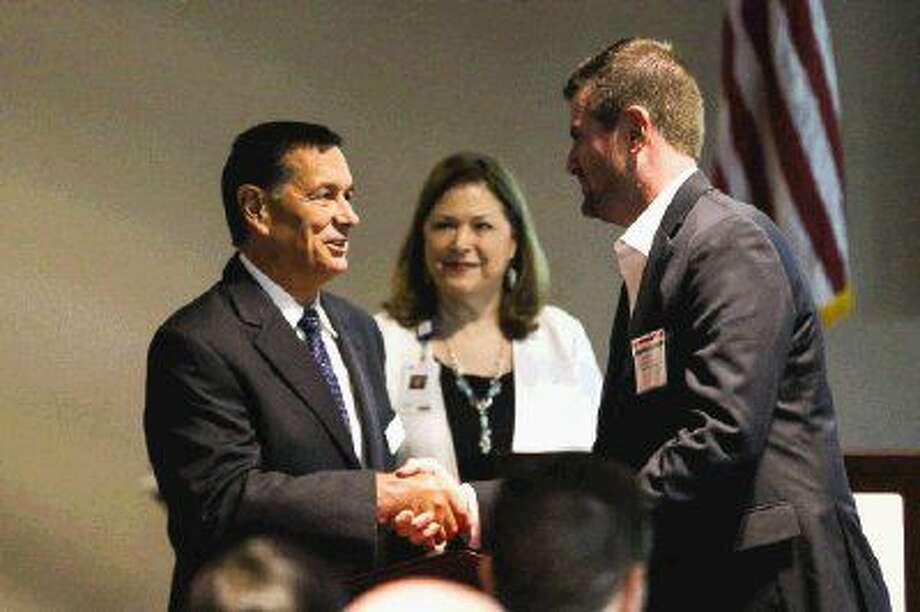 Stephen McKernan, CEO of Lone Star Family Health Center, left, shakes hands with state Sen. Brandon Creighton, R-Conroe, during the Elected Officials Appreciation Lunch on Friday, Aug. 12 at Lone Star Family Health Center in Conroe. Photo: Michael Minasi