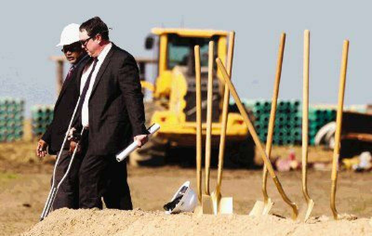 Montgomery ISD Superintendent Beau Rees, right, talks with Chris Bent, associate principal at Huckabee, at the construction site of Montgomery ISD's new Lake Creek High School Thursday in Montgomery.