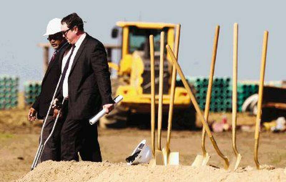 Montgomery ISD Superintendent Beau Rees, right, talks with Chris Bent, associate principal at Huckabee, at the construction site of Montgomery ISD's new Lake Creek High School Thursday in Montgomery. Photo: Jason Fochtman