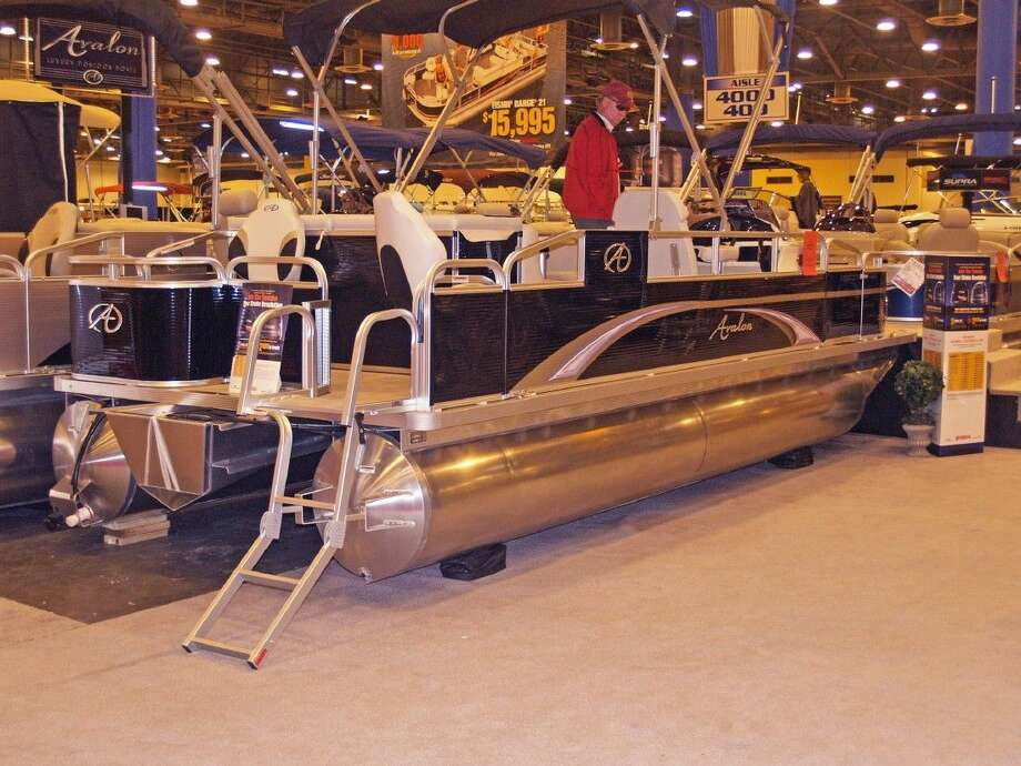 Many people do not regularly buy trailers when they buy a new boat. This pontoon boat at the boat show is an example.