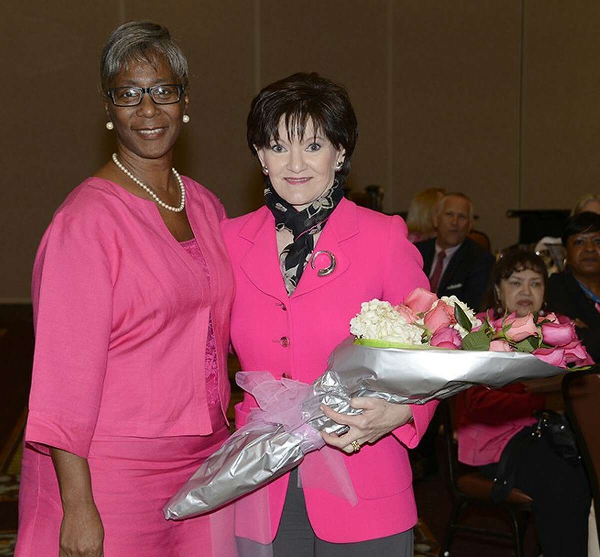 Featured speaker Beth Sanders Moore, left, and breast cancer survivor Bettye Washington, a Harris Health System employee, attend the Harris Health System Breast Cancer Survivors Luncheon on Oct. 4 at the Bayou City Event Center.