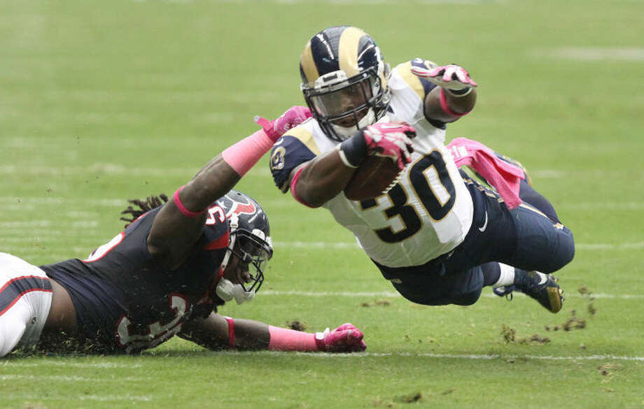 Houston Texans' D. J. Swearinger brings down the St. Louis Rams' Zac Stacy Oct. 13 at Reliant Stadium.