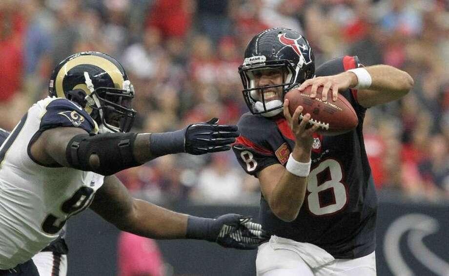 Texans quarterback Matt Schaub is pressured by St. Louis Rams defensive tackle Michael Brockers. The Rams won 38-13.