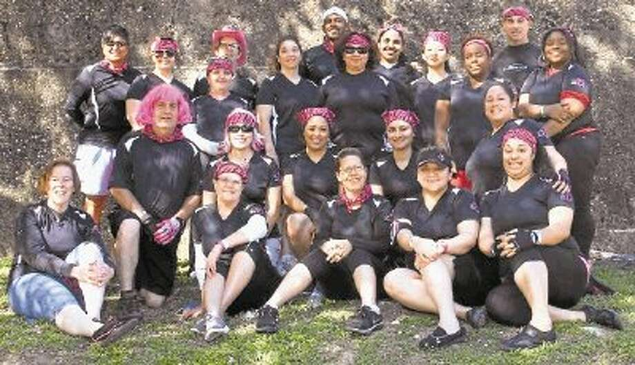 """Breast Cancer Dragon Boat team """"All Hands Abreast"""" at the Houston Dragon Boat Festival last May, where the team won its first final in a breath-taking and decisive victory. Photo: Submitted Photo / @WireImgId=2642940"""