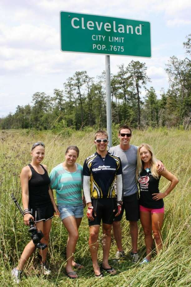 Kacie Fischer, far right, is skating from California to New York City on inline skates in an attempt to break several world records. Her support team passed through Cleveland on May 29. Shown from left to right are Heather Elgie, Melinee Fischer, Kevin Crossman, Adam Cleveland and Kacie Fischer. Photo: MELECIO FRANCO