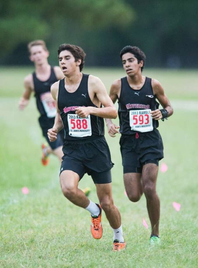 A pair of St. John's cross country runners make the turn for home Friday afternoon at the St. John's Ramble at T.C. Jester Park. Photo: Kevin B Long