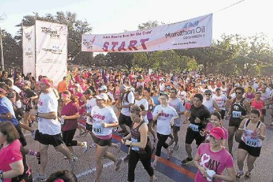 Runners start at the Komen Race for the Cure in Houston Oct. 5. Photo: Photo By Alan Warren / @WireImgId=2645170