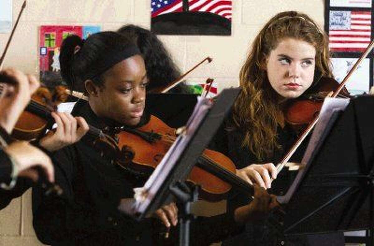 The Woodlands High School orchestra performs prior to the Veterans Day celebration at Moorhead Stadium Wednesday, Nov. 11, 2015. To view or purchase this photo and others like it, visit HCNpics.com.