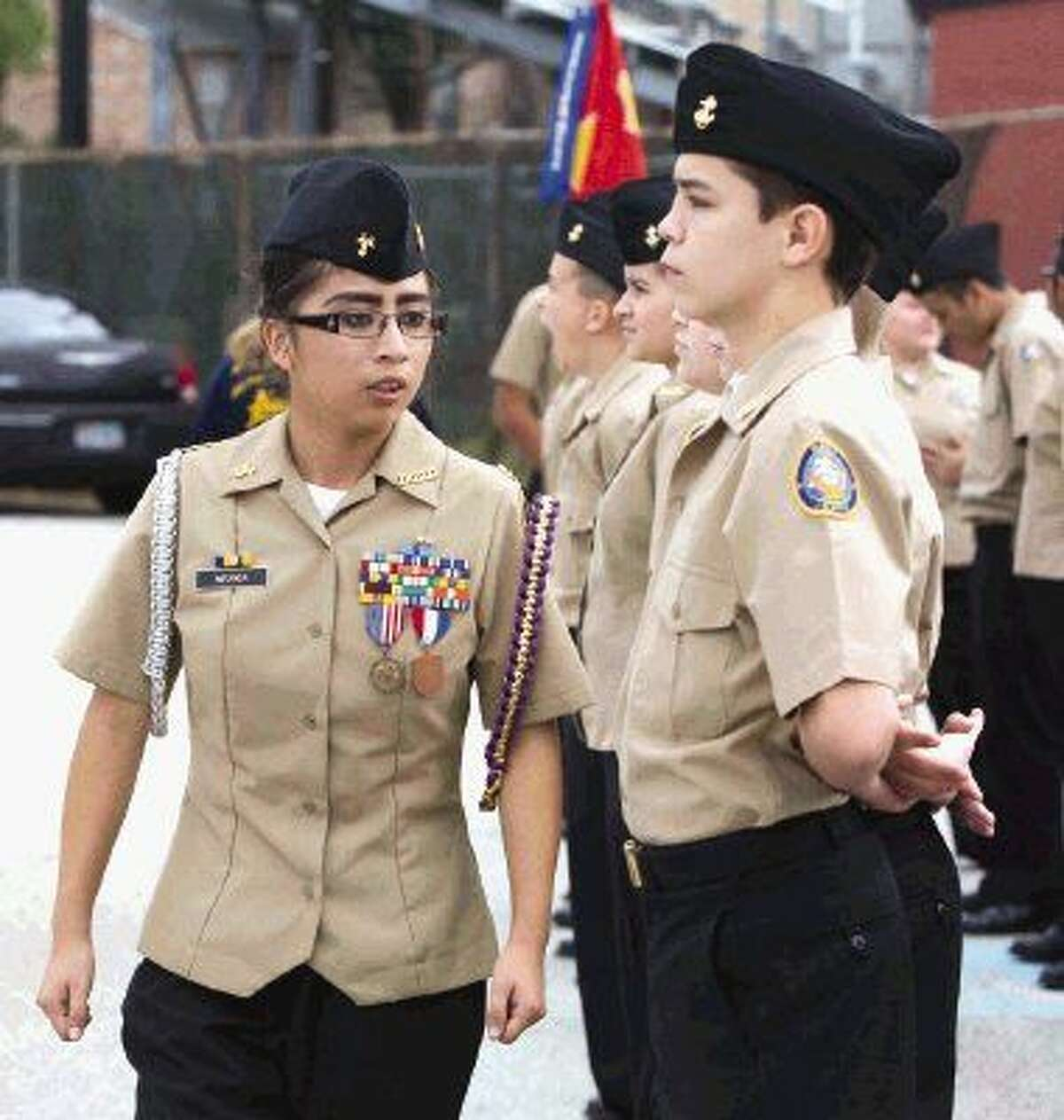 Caney Creek JROTC cadet Esoy Miranda inspects uniforms prior to the Veterans Day celebration at Moorhead Stadium Wednesday, Nov. 11, 2015. To view or purchase this photo and others like it, visit HCNpics.com.