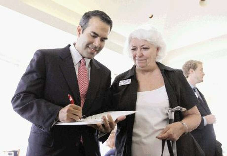 George P. Bush, nephew of former President George W. Bush, signs an autograph for Betty Ann Tolbert after speaking at the North Shore Republican Women's meeting at Bentwater Yacht Club Wednesday. Bush is a candidate for Texas general land commissioner in 2014. Go to HCNPics.com to view more photos from Bush's visit. / Conroe Courier