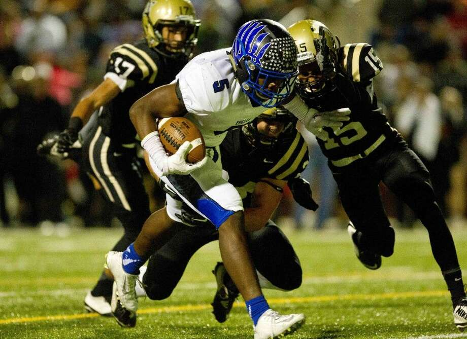 New Caney running back Marte Allison picks up a first down near the goaline in the second quarter of a Class 5A-DI bi-district playoff football game Saturday, Nov. 14, 2015, in Beaumont. To view or purchase this photo and others like it, visit HCNpics.com.