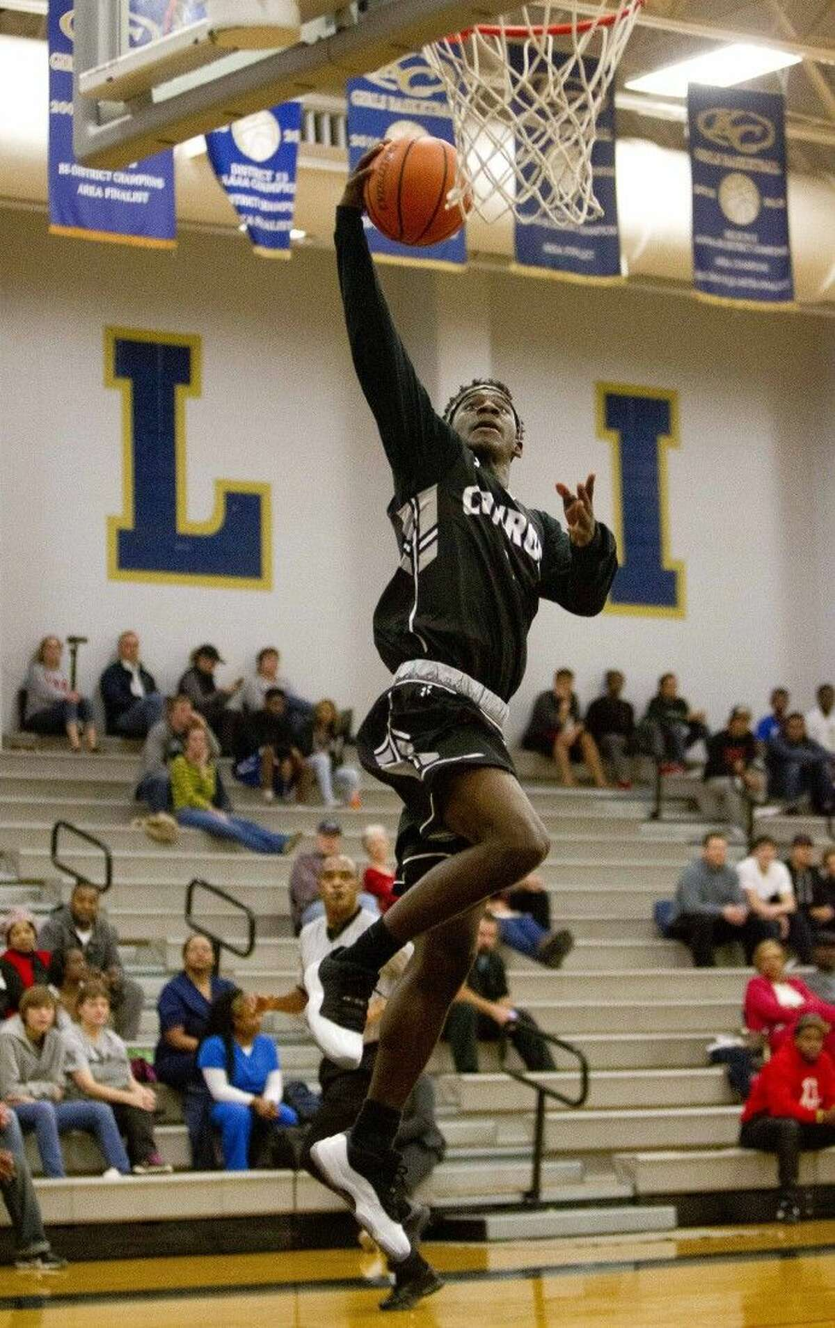 Conroe's Jay Lewis goes for a dunk during a high school basketball game Tuesday in Spring.