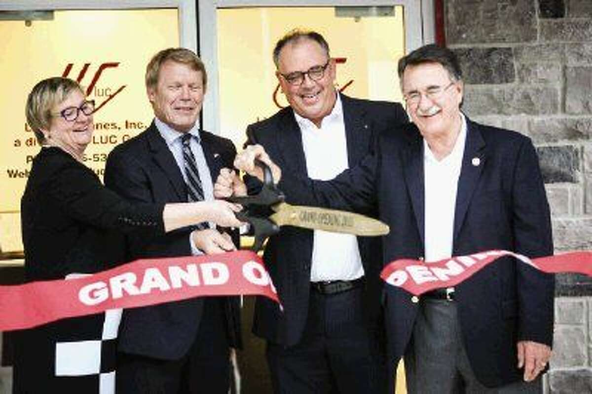 Suzanne and Charles Krutzen, owners of LUC Urethanes, Inc., Jos Wellink, Honorary Consul for the Kingdom of the Netherlands, and Conroe Mayor Webb Melder participate in the ribbon cutting ceremony on Friday, Nov. 20, 2015, at the new LUC Urethanes, Inc. plant in Conroe. To view more photos from the ceremony, go to HCNPics.com.