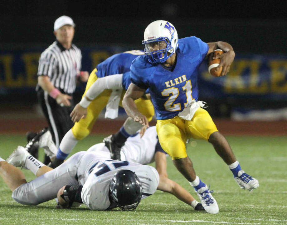 Klein running back David Hamm (21) looks to run during a District 13-5A football game at Klein Memorial Stadium earlier this year. Photo: Staff Photo By Jason Fochtman