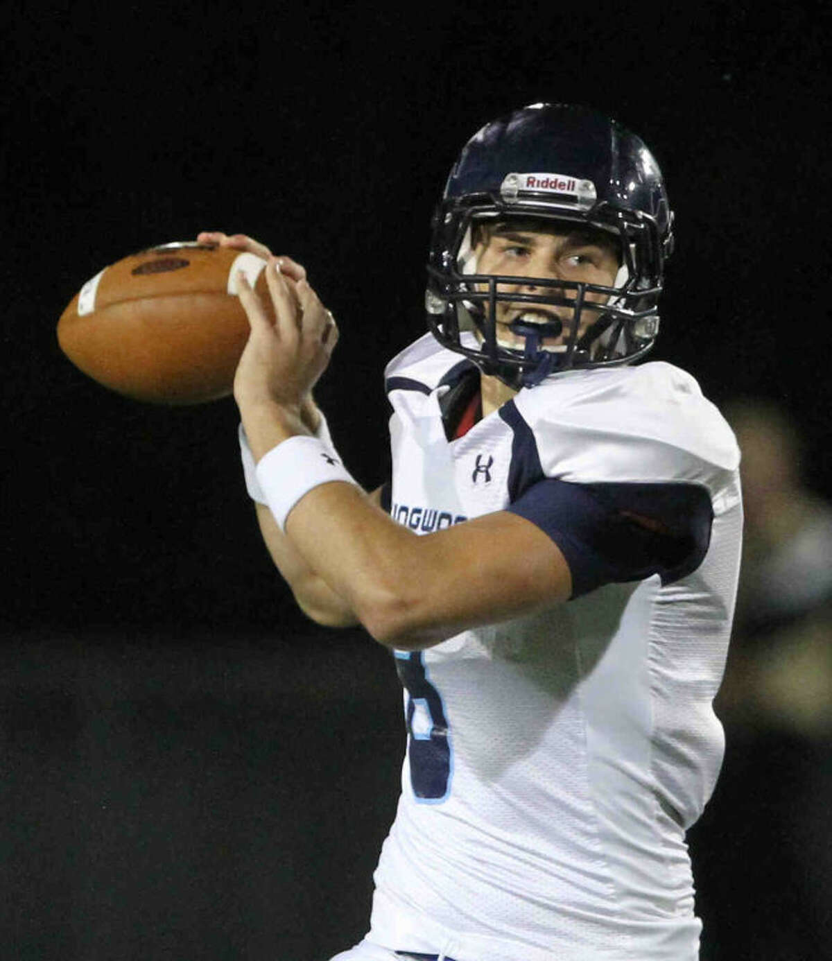 Kingwood's Logan Clift (8) throws the ball during a District 13-5A football game at Klein Memorial Stadium Thursday.