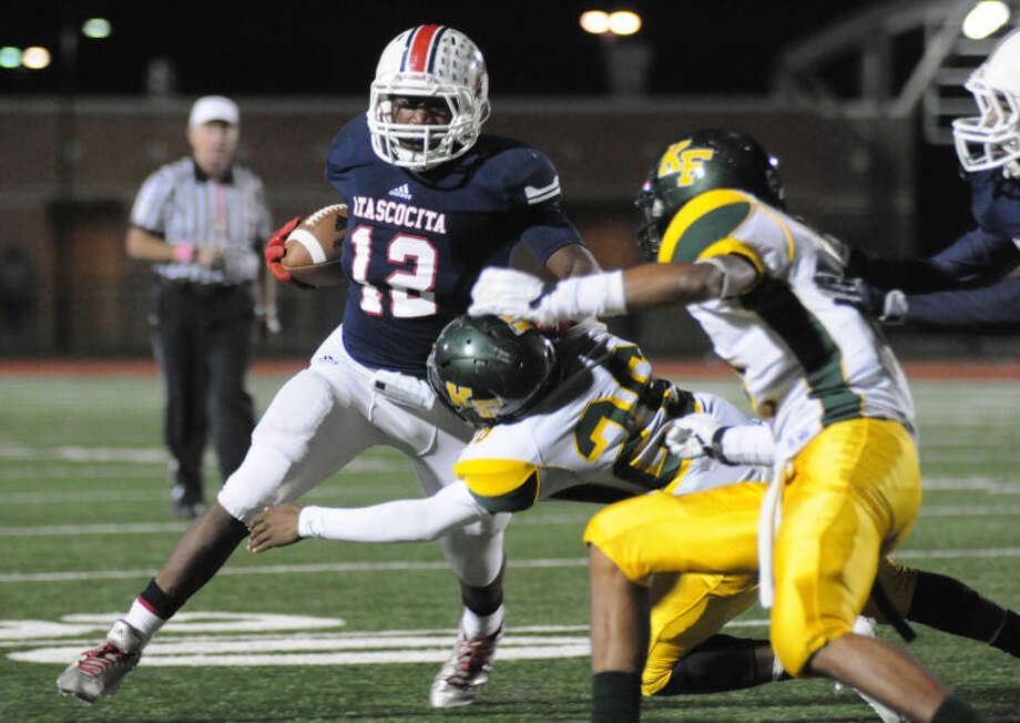 Atascocita's Jemarcus Jones fights off a defender against Klein Forest on Thursday at Turner Stadium.