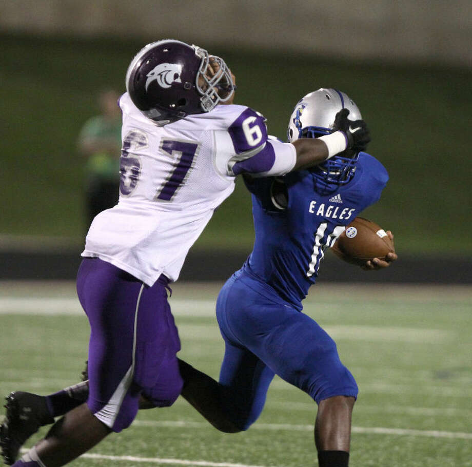 Ridge Point's Torian Williams tries to stop Willowridge's Donald Mitchell during their District 22-4Agame Oct. 17 at Hall Stadium in Missouri City. The Panthers won 49-0 to stay undefeated indistrict. To view or purchase this photo and others like it, go to HCNPics.com.