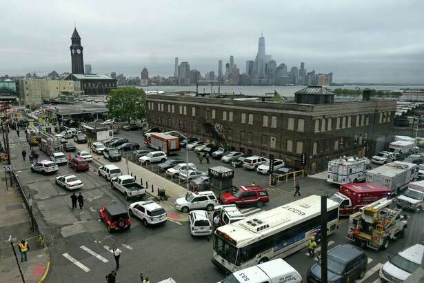 The skyline of New York's borough of Manhattan is seen behind the Hoboken, N.J. rail station after a train crash at the facility on Thursday, Sept. 29, 2016. A commuter train plowed into the bustling terminal during the morning rush hour. (AP Photo/Joe Epstein) ORG XMIT: NJJE104