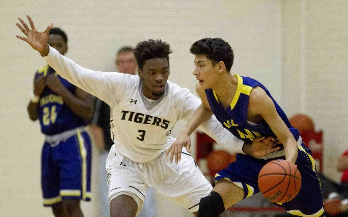 Conroe's Marcus Keyser, of Conroe, guards Jersey Village Ivan Toscano during a high school basketball game Wednesday in Conroe.