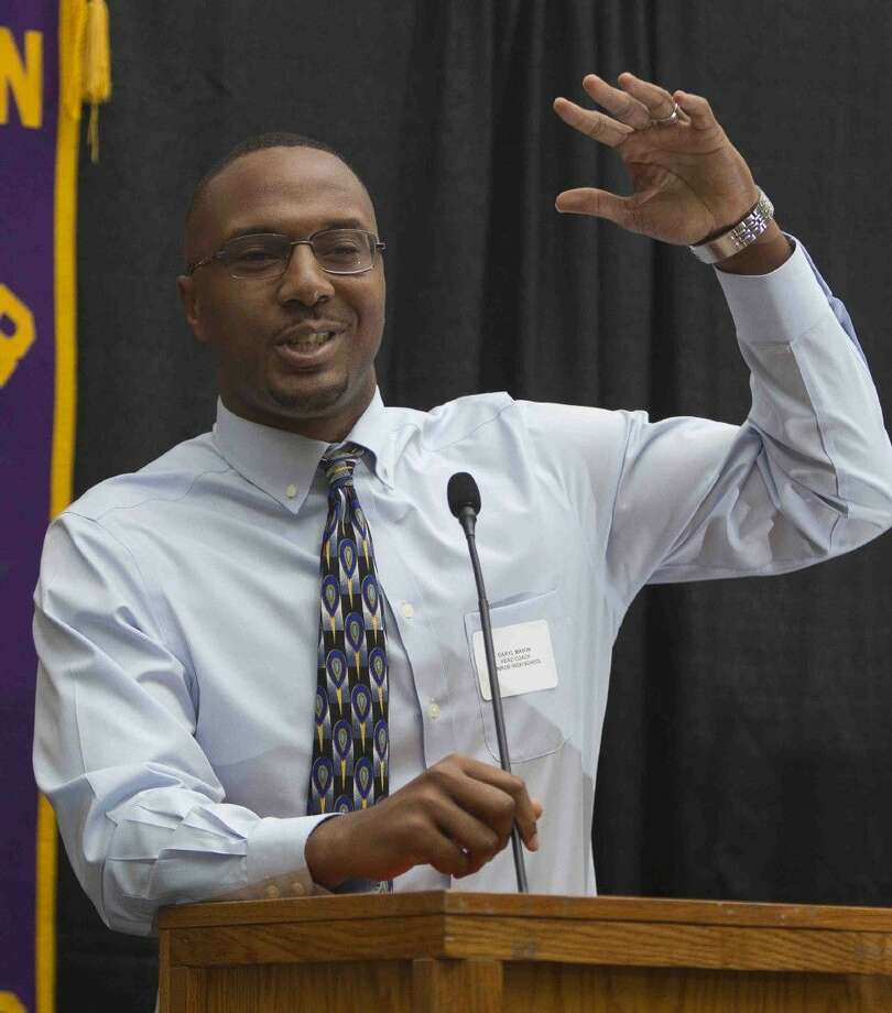 Conroe coach Daryl Mason speaks about the upcoming basketball season at the Conroe Noon Lions Club meeting Wednesday. Photo: Jason Fochtman