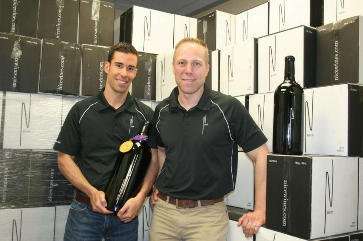 Ryan Levy (left) and Ian Eastveld, Le Cordon Bleu-trained chefs pursuing the wine business, produce handcrafted, award-winning boutique wines out of an industrial park office in northwest Houston. The wine cases are stored in the office's backroom until the bottles are delivered to area restaurants and individual customers.