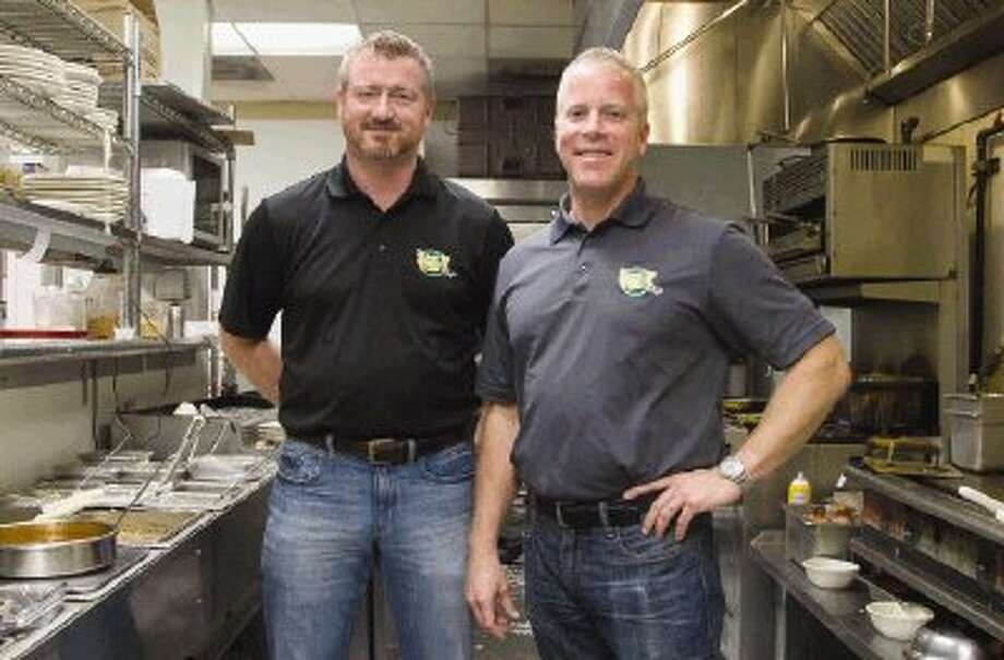 Mathew DeMott, left, and Chris Milton opened the Toasted Yolk Cafe in Conroe in 2010. The restaurant began serving breakfast and lunch but recently started serving dinner as well. Photo: Staff Photo By Ana Ramirez / The Conroe Courier