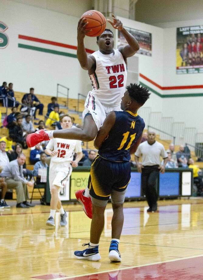 Romello Wilbert, of The Woodlands, goes up for a shot as guard Darrell Braxton, of Nimitz, defends during the first half of a boys basketball game Tuesday, Dec. 8, 2015, in The Woodlands. To view or purchase this photo and others like it, visit HCNpics.com. Photo: Jason Fochtman
